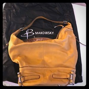 B. Makowsky mustard color hobo bag